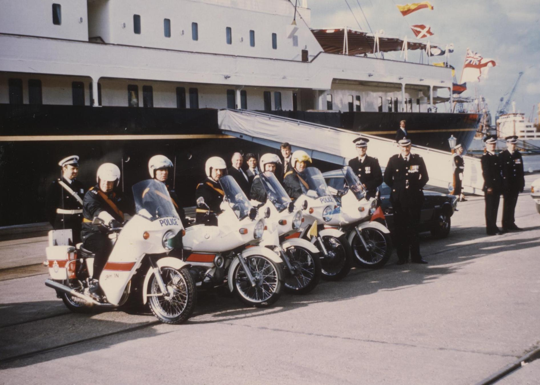 Police officers on motorbikes in front of Royal Yacht Britannia for Her Majesty The Queen's visit to Humberside 1977 (archive ref CCHU-4-1-9-2)
