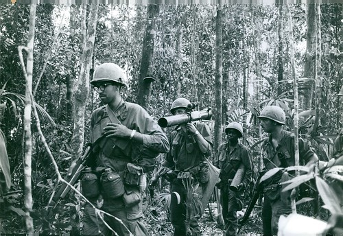 DAKTO 1967 - U.S. soldiers raking through the jungle to go after enemy in the Vietnam War