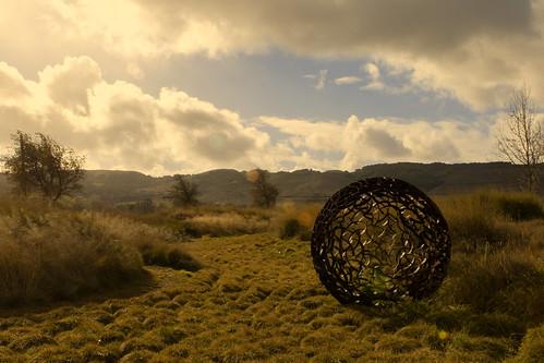 art metal ball canon7dmarkii sonoma ca california sun glare clouds sky bushes hills warm glow grass shrubs green 2470mm unitedstates us sanden