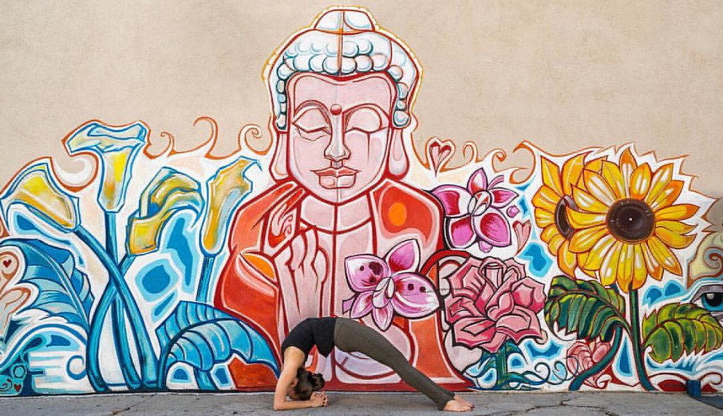 Inverted Staff pose, Viparita Dandasana: Santa Monica, California, USA  🌞 Karen: This beautiful mural was just begging for some yoga love, and I always love me a good heart opener. :-)  📷 Ben: This mural is on the edge of a parking lo