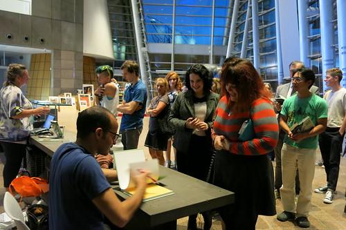 Anis Mojgani signing books