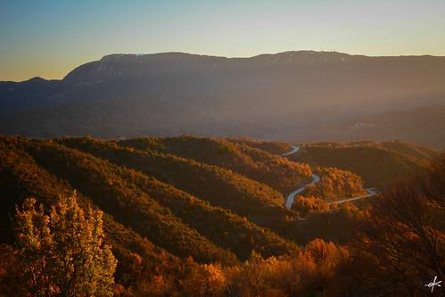 road winter sunset mountain colors landscape gold golden countryside hellas greece countryroad mountainous epirus zagorochoria zagori kapesovo