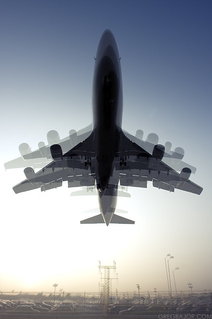 Multiple exposure of landing planes. Boeing 777, 747 and Airbus A340, A380.