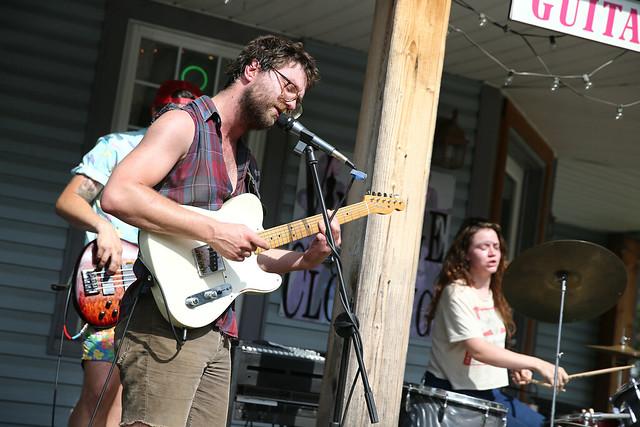 Band outside music shop