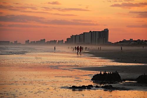 light sunset beach water america dusk unitedstatesofamerica southcarolina beautifullight shore coastline tidal goldenhour northmyrtlebeach southernstates nikond40x photographybychristopherstrickland
