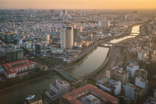 travel sunset skyline skyscraper river landscape asia southeastasia cityscape sony wideangle aerial vietnam saigon hcmc hochiminh carlzeiss a7ii leadingline bitexco
