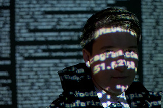 Code projected onto man's face | by Vlad Yaitskiy