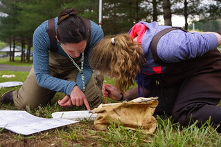 Jenny Sanders helps a student with animal identification | by USFWS/Southeast