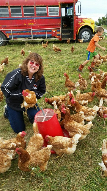 A woman with the hens