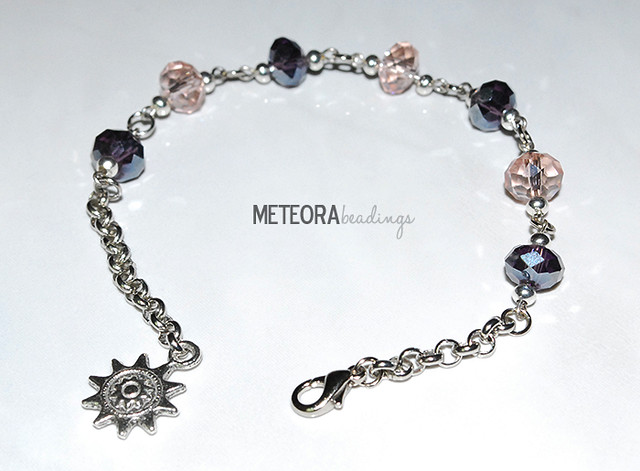 Bracelet - dark purple and light pink beads, with silver chain and sun charm