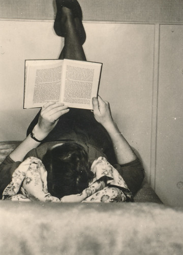 Woman reading a book in bed | by simpleinsomnia