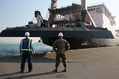 The ramp is lowered from USNS MAJ Stephen W. Pless (T-AK 3007), one of two ship Military Sealift Command ships delivering equipment for exercise Cobra Gold in Thailand.  (U.S. Navy/Grady T. Fontana)