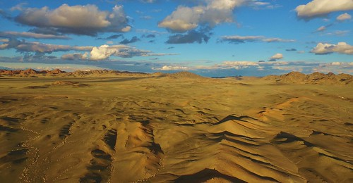 blue red orange mountains asia desert mongolia centralasia gobidesert snowleopards altaimountains protectedareas tostuul