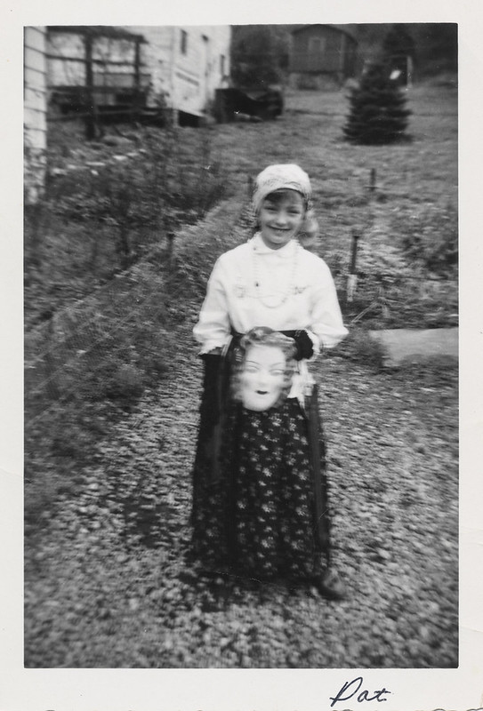 Little girl holds a mask