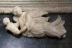 angel bearing up a swaddled babe