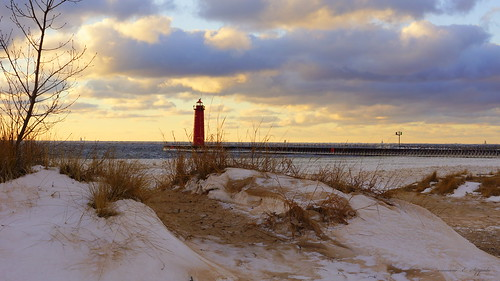 winter lighthouse ice beach clouds harbor pier sand waves lakemichigan lakeshore sanddunes muskegon dunegrass coastalliving midweastliving usasfourthcoastline pierarms windnsky