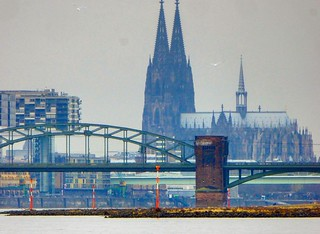 View downstream the Rhine from Rodenkirchen. Südbrücke and one of the three Kranhäuser are framing the shot, but Cologne Cathedral towers it all!   by 2composers