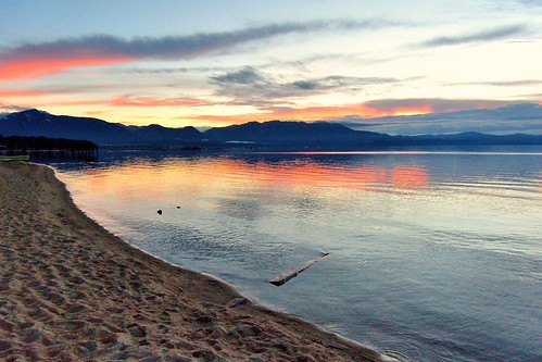 california blue sunset orange lake mountains reflection beach sand laketahoe southlaketahoe joelach