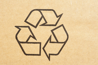 Recycle symbol stamped on cardboard