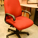 Red swivel chair with arms