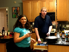 Jason and Allie Potts prepare dinner for their guests. Guess Who's Coming to Dinner is one of the most fun socials the club holds. Guests do not know who their host is until the door opens. Hosts do not know who their guests will be.
