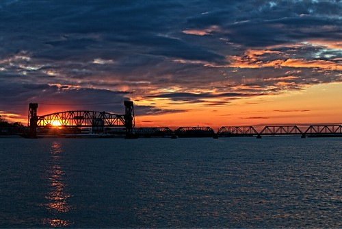 sunset red sky orange water clouds river tennesseeriver decaturalabama