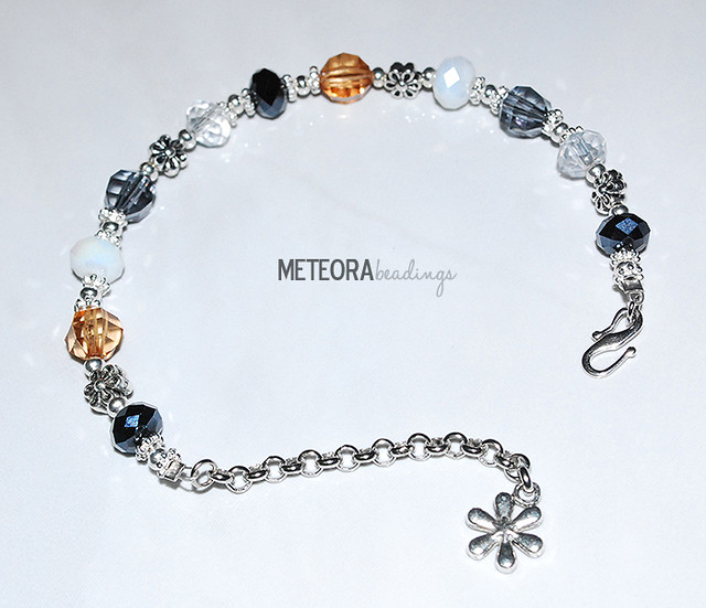 Bracelet - brown, black, white and clear beads, with silver chain and flower charm