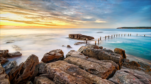 longexposure blue sky seascape texture beach yellow rock composition sunrise landscape interesting rocks colorful whitewater cloudy overcast nsw maroubra firstlight rockformation mahonrockpool