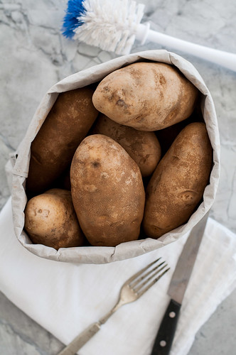 Baked potato ingredient and tools | by tessascotolson