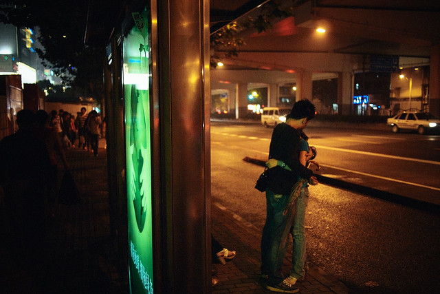 Lovers waiting for bus