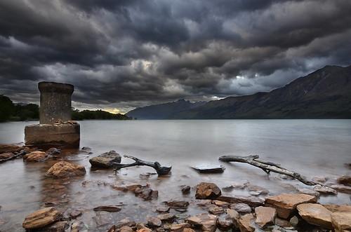 newzealand lake storm mountains water clouds landscape rocks dusk gimp mooring southisland wakatipu lakewakatipu waterscape widelens southernlakes d7000 queenstownlakes tokinaaf1228mmf4
