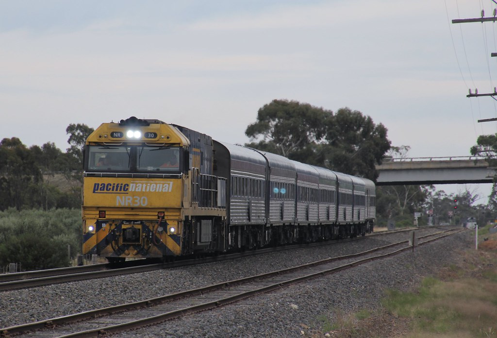 NR30 rolls the Overland into Dimboola with NR84 stabled in the loop in the background by bukk05