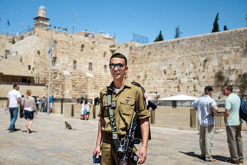 Young Israeli soldier in front of the Western Wall in Jerusalem, Israel | by Kristoffer Trolle