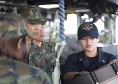 Ensign Beatrice Cayaban discusses equipment on the bridge of USS Ashland (LSD 48) with members of the Royal Thai Navy Armed Forces during a tour of ship. (U.S. Navy/MCSN Kelsey L. Adams)