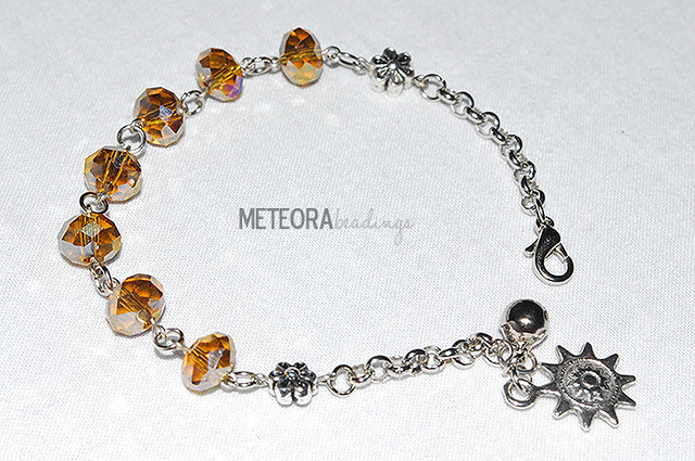 Bracelet - brown beads with silver chain, connector, sun charm