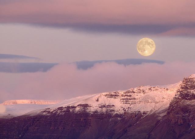 Full moon over mount Esja