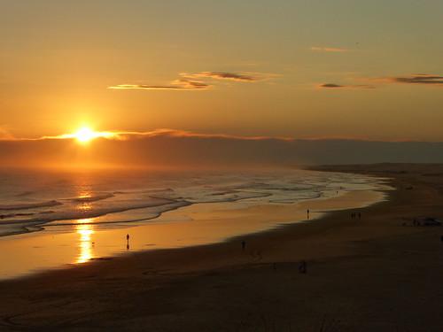sunset beach water surf birubi