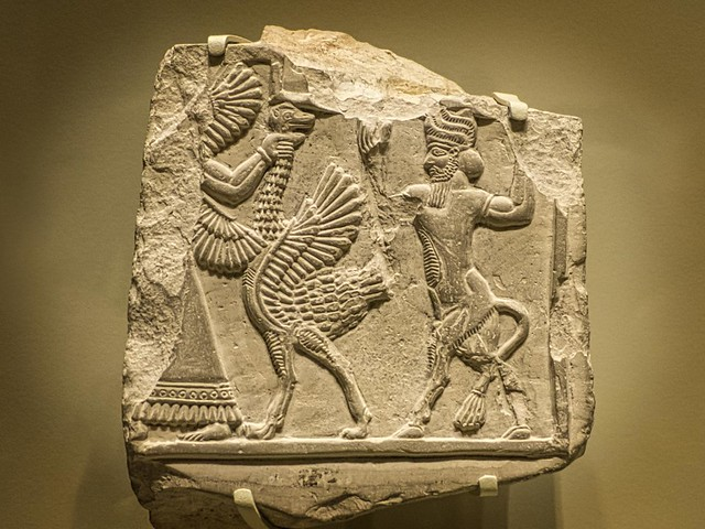 Elamite relief fragment with ostrich and genius (human-headed bull) 721-464 BCE