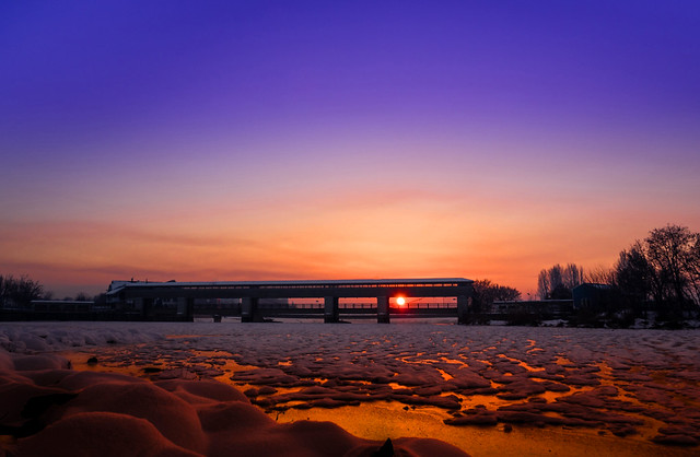 Sunset over the frozen river