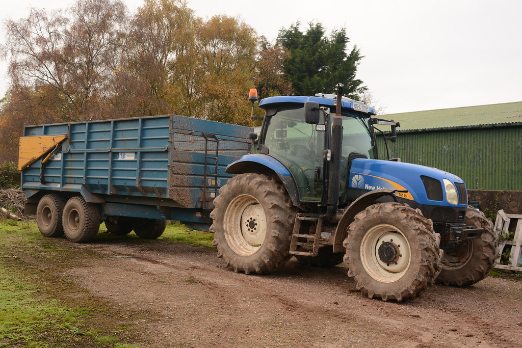 New Holland TS115A Tractor with a Kane Trailers Trailer | Flickr