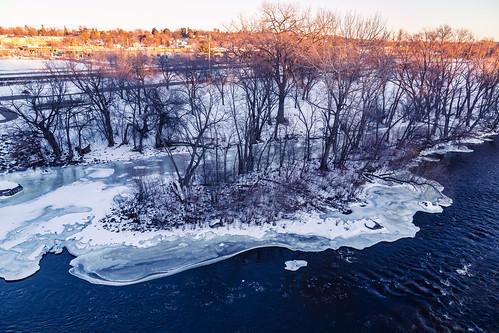 winter sunset snow ice minnesota river us unitedstates mississippiriver saintcloud stcloud bentoncounty saukrapids stearnscounty waitepark saukrapidsregionalbridge