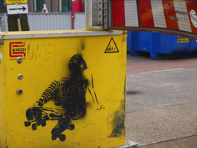 2016.04 - Amsterdam photo of urban street-art; stencil-art on a temporarily road barrier for regulating the tram traffic on the track; geotagged free urban picture, in public domain / Commons; Dutch photography, Fons Heijnsbroek, The Netherlands