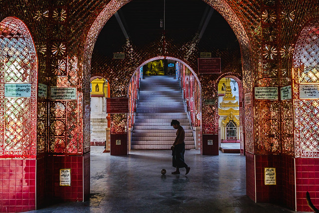 Man walking by Mahar Thatkyarthiha Pagoda
