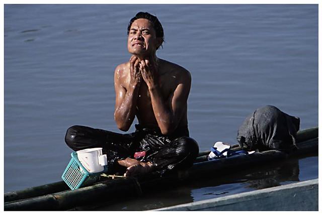 man taking a bath in chindwin river