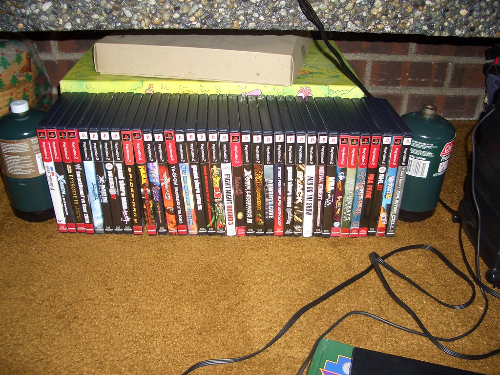 My Bro's PS2 and his games.
