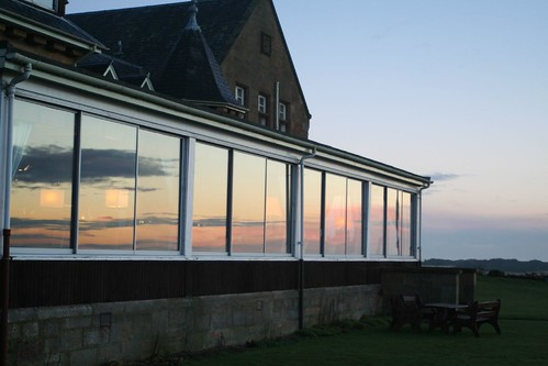 Sunrise reflected in conservatory windows   by foxypar4