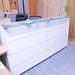 Large white laminate and glass reception counter