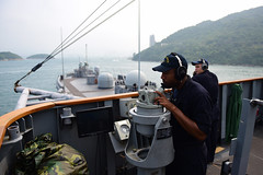 Quartermaster Seaman William Reeves, attached to the U.S. 7th Fleet flagship USS Blue Ridge (LCC 19), records surface contacts as the ship arrives in Hong Kong. (U.S. Navy/MC3 Jordan KirkJohnson)