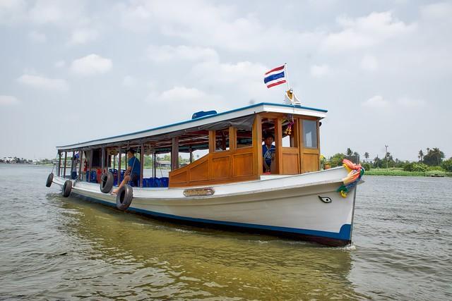 Tourist boat on the Chao Phraya river at Ko Kret, an island near Bangkok, Thailand