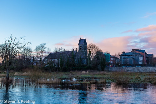 city ireland church wet water architecture clouds reflections river landscape evening ennis waterways countyclare riverfergus